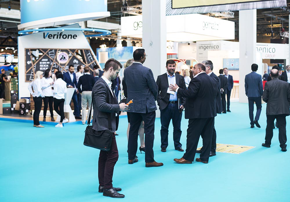 Businessmen standing around the conference hall of Money20/20 Europe 2017