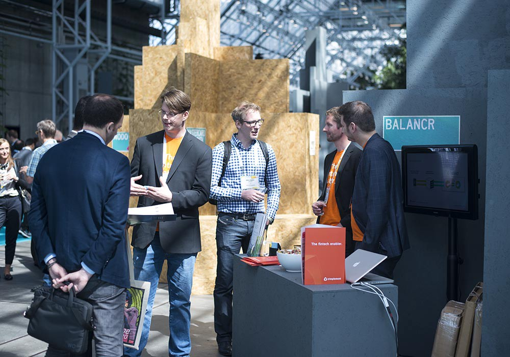 The balancr team speaking with customers at the Money20/20 Europe conference in 2017.